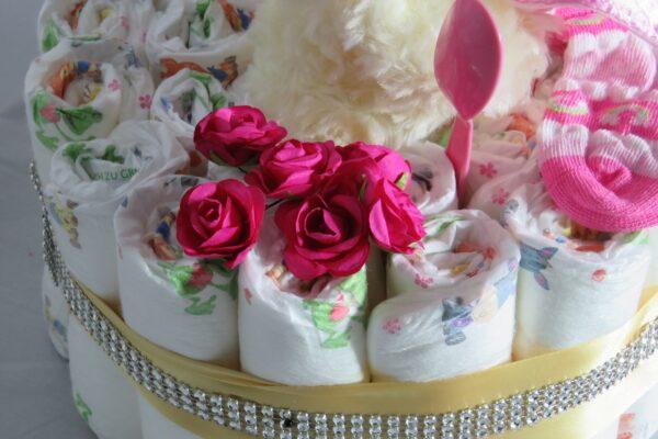"""Windeltorte Cupcake """" Pinky"""" mit Schlafteddy rosa 32-teilig 3"""
