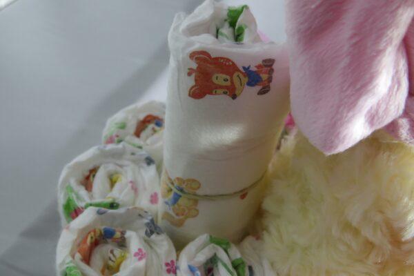 """Windeltorte Cupcake """" Pinky"""" mit Schlafteddy rosa 32-teilig 8"""